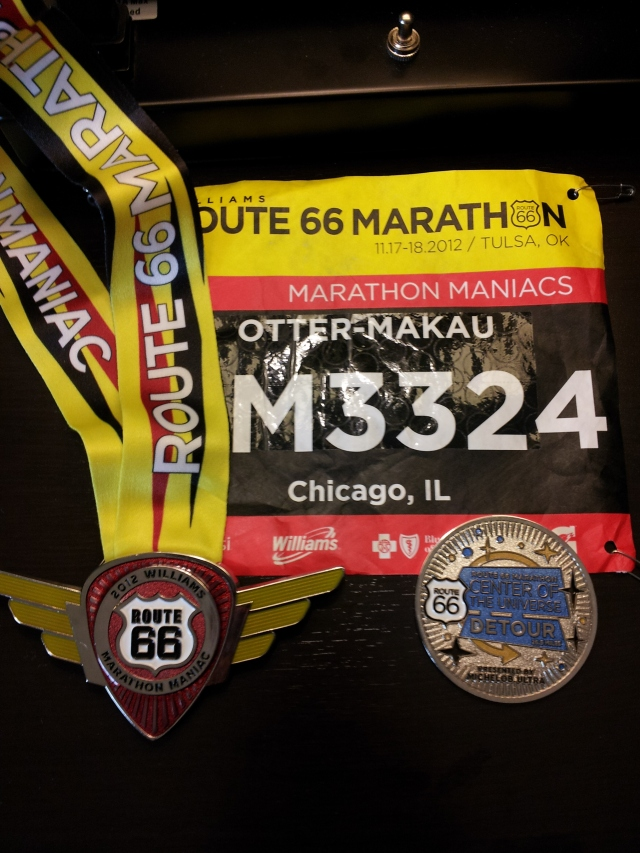 Medal, bib, and Center of the Universe Detour coin. They let us personalize our bibs, so I combined my name with that of the current marathon world record holder