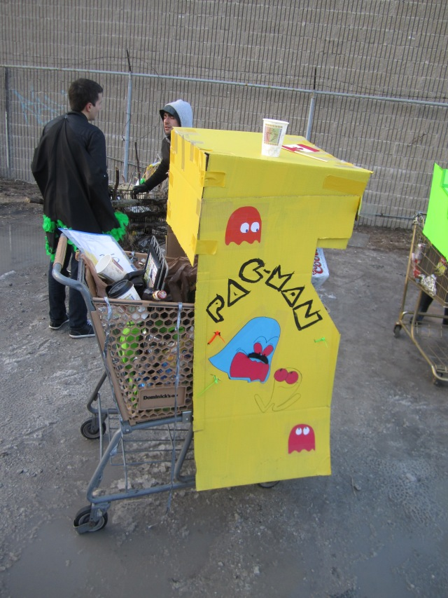 Here's a side view of our cart at the last bar stop -- at some point, our ghost on the side gained a mustache