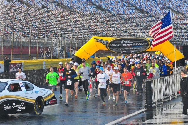 This photo is courtesy of the NC Half Marathon's Facebook page -- I assumed that the loud vrooming that we heard was a pre-recorded noise pumped in on the PA system, but NOPE, it was an actual race car